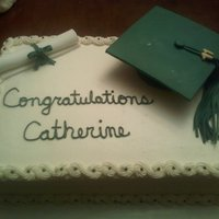 Graduation   This was a college graduation cake. Buttercream icing with fondant cap and diploma. I need a lot of work on my writing skills!!