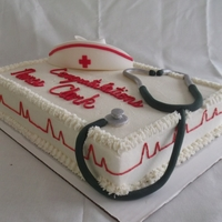 Nursing Graduation Cake   Chocolate cake covered in buttercream icing. The nursing cap and the stethoscope are made out of gumpaste