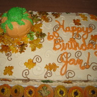 Fall Fun This cake is covered in BC with painted fondant leaves and a BC covered pumpkin.