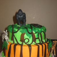 Jungle Cake This cake was a lot of fun to make. It was short notice so I didn't have time to make the animals but it still turned out cute.