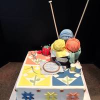 Quilters Retirement Cake *Gumpaste pin cushion, balls of yarn, quilt pattern ,tracing wheel, scissors, cross stitching, and knitting needles.