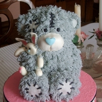 Tatty Teddy Bear Cake Make this for my MIL for Mother's Day. Used a bear pan and then shaped the limbs as if he is holding a bunny toy.