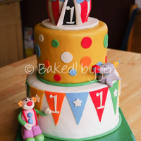 Circus 1St Birthday Cake For a circus themed 1st birthday party. The bottom tier is white with strawberry SMBC and iced in vanilla SMBC. Middle tier is chocolate...