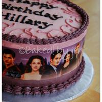 "Twilight/breaking Dawn Birthday Cake 8"" white cake with strawberry filling, iced in buttercream. The wraparound is an edible image."