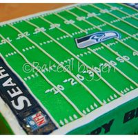 Seattle Seahawks Birthday Cake 9x13 yellow cake with strawberry SMBC filling, iced in buttercream. All the images are copied onto cardstock and laminated and are non-...