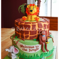 Jungle Safari Baby Shower My first time making fondant characters, and I really like how it all came together. Chocolate cakes filled and iced with vanilla Swiss...