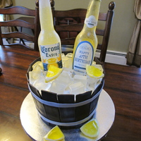 Beer Bottle Cake Beer bottles and ice cubes are made of isomalt. Lemons are Jell-o inside.