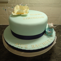 Birthday Cake For 'the Blue Rachael' 8 inche round chocolate cake with Tiffany Blue fondant, a fantasy flower made from flower (gum) paste.....and......my Granddaughter calls...