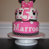 Minnie Mouse Cake  This cake was make for two little girls celebrating their birthdays together. one side says Marron the other Erin. All vanilla fondant...