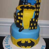 Batman Cake This cake is covered in fondant. All buildings and batman symbol are make with gumpaste.