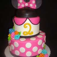Minnie Cake Two tier cake with a 3rd small tier of cake for the head where the ears are.