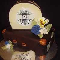 Honeymoon Cake was for a bride who was going on a big honeymoon & her bridal shower was travel theme.