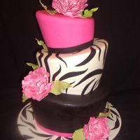 Zebra Fun! Cake (before I finished if) for 50th b-day. Topsy turvy covered in fondant. Gumpaste flowers w/lustre finish.