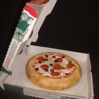 Papa John's Pizza Cake in a Papa John's box, because that was the groom's favorite. The box is a real box (not edible)