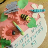 Half Birthday Cake Bug themed half birthday cake. Cake is buttercream iced. Bugs and other embellishments are fondant.