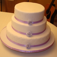Wedding Cake 3 Tier Lavender wedding cake. Back view w/roses