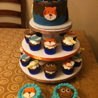 Noah's Ark Cupcake Tower We loved making our Cupcake Towers! First Birthday for Twin boys so the Smash Cakes were also provided. All decorations are made out of...