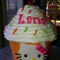 Hello Kitty Jumbo Cupcake Cake  I think this turned out so cute! We love making anything Hello Kitty! Everything edible on cake except for stem on cherry. All decorations...