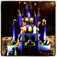 Disney Villain Castle Cake   We absolutely loved the way this cake came out! Hope you do to! Entire cake is edible except disney figurines.