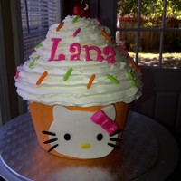 Hello Kitty Giant Cupcake We love our giant cupcake! Strawberry cake with strawberry filling. All fondant decorations.