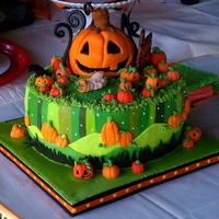 Halloween Themed Baby Shower Design was inspired by a tissue box. Most decorations were made with MMF and royal icing. The large jack o' lantern was made from RKT...