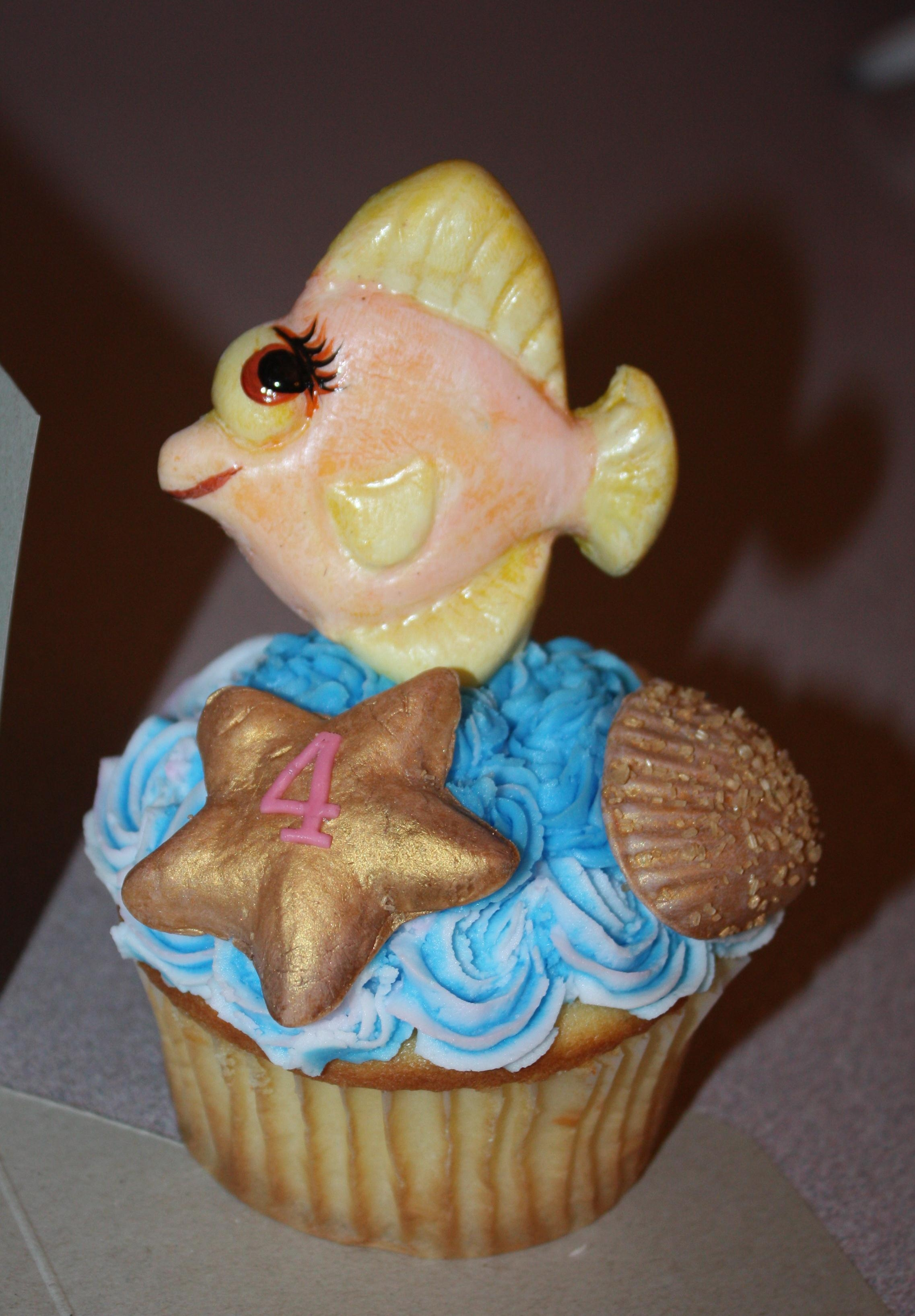 Sea Creature Cupcakes   pressed white gumpaste/fondant into mold, when dry hand painted with foodcolor