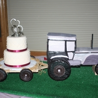 Tractor Wedding Cake   tractor is carved from white cake, tires are rice cereal & modeling chocolate. tired cakes are strawberry & chocolate