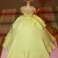 Cinderella Dressed In Yellow  Back view. I wish I would have placed the bow higher. I added it before I set the doll in place so didn't realize it needed to be...