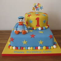 Quack! Quack! Donald Duck themed cake for a first birthday.Models made from sugarpaste with CMC added.