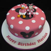 Minnie & Daisy Girl's birthday cake with models of Minnie Mouse & Daisy Duck