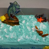 Fishing Made this for a coworker brother in law birthday. Yellow Cake With Buttercream Icing and fondant decoration. Boat is made of yellow cake...