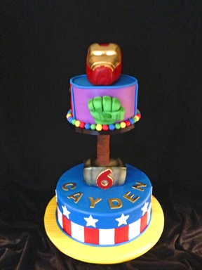 "Avengers Birthday Cake Avengers cake for my grandson's birthday. Bottom tier is 3-layer, 12"" round. Hammer head is RKT covered with candy clay and..."