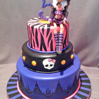 Monster High 'wolf Girl' Cake 3-Tier cake design inspired by clothing worn by Monster High doll. Bottom tier features Ophelia Cake Lace applied upside down to mimic the...