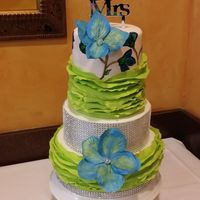 Green And Blue Weeding Cake Hand paint, rice paper flowers and ruffle. Green and blue combination