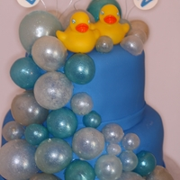 Rubber Ducky Baby Shower Based off of ChristysConfections cake. This was my first time trying gelatin bubbles. Once I got the hang of it, I really enjoyed making...