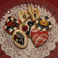 Queen Of Hearts Cookies My Almond Sugar cookies with Almond icing. Roses, crown, and lock and keys made from chocolate fondant tinted black. Used gold dragee and...