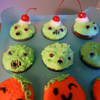 Halloween Cupcakes I wanted it to look like the cupcakes turned into rabid zombies! lol