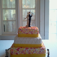 Michael And Annie's Cake 3 tier square wedding cake with yellow ribbon on the bottom