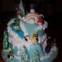 Winter Fun Butter-almond base tier, chocolate second tier. Fondant covered with fondant penguins, covered sugar cones for trees, lots of glitter!
