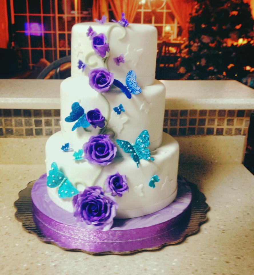 Blue To Lilac Butterflies And Purple Roses. Butterflies are the symbol to the Quinceañeras, because they represent the change from a little girl to a beautiful lady.