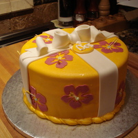 Hawaiian Birthday Cake Used my Cricut Cake to cut out the Hibiscus flowers. Used airbrush to mist with pearl sheen.