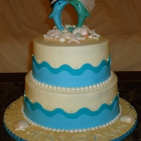 Beach Themed Bridal Shower  I made this cake for my best friend for her bridal shower! I wanted a romantic beach setting for her. She loves dolphins so I made a...