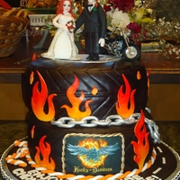 Harley Davidson Groom's Cake  I made this cake for a friend of mine's daughter getting married. This was the first time I made gumpaste/fondant people and it was by...