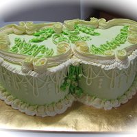 65Th Anniversary buttercream green joined hearts with Lambeth piping and string work.Lilly of the valley piped flowers