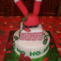 Santa Needs A Diet!   10 inch round snickerdoodle cake. Iced in buttercream. Santa is made from rkt and covered in fondant.