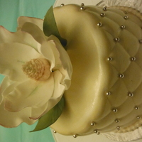 Magnolia vanilla cake with buttercream covered in fondant with a gumpaste magnolia flower