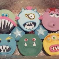 Monster Cupcakes Wanted to post some cupcakes to my nephew and had a lot of scraps of fondant of all sorts of colours leftover from other cakes so used the...
