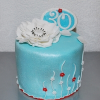 Elegance In Egg Shell Blue, White & A Touch Of Red This customer really gave me carte blanche on the 30th Birthday Cake for her sister and just told me her sister loved the purple dotted...