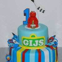 Sesame Street's Elmo & Big Bird Cake Gijs would be celebrating his 1st Birthday and his mom requested a Sesame Street Cake with Elmo as the star and if possible 1 or 2 other...