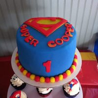 Super Cooper Super Hero Cake And Cupcakes *Super Hero Fondant cake with caped cupcakes